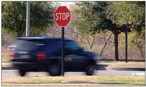 Car running stop sign